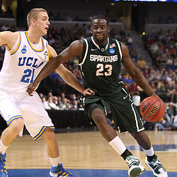 Mar 17, 2011; Tampa, FL, USA; Michigan State Spartans forward Draymond Green (23) drives past UCLA Bruins forward Brendan Lane (21) during the first half of the second round of the 2011 NCAA men's basketball tournament at the St. Pete Times Forum.  Mandatory Credit: Derick E. Hingle