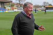 AFC Wimbledon manager Wally Downes stood on the pitch during the EFL Sky Bet League 1 match between AFC Wimbledon and Gillingham at the Cherry Red Records Stadium, Kingston, England on 23 March 2019.