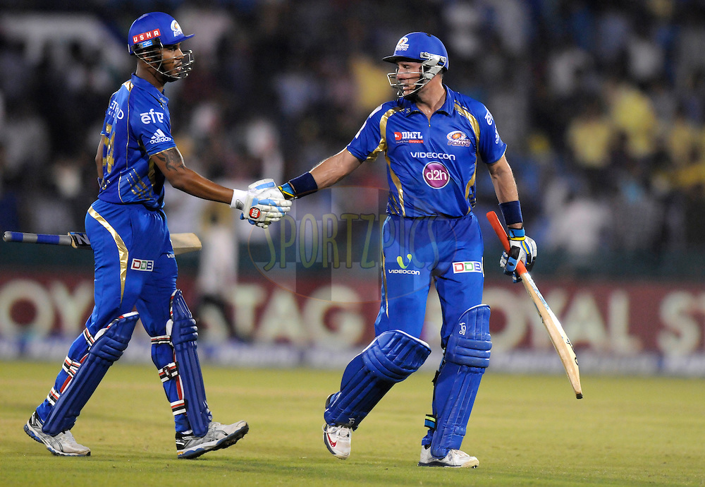 Lendl simmons of Mumbai Indians congratulates teammate Michael Hussey of Mumbai Indians walks back after getting out during the qualifier 4 match of the Oppo Champions League Twenty20 between the Mumbai Indians and the Southern Express held at the Chhattisgarh International Cricket Stadium, Raipur, India on the 14th September 2014<br /> <br /> Photo by:  Pal Pillai / Sportzpics/ CLT20<br /> <br /> <br /> Image use is subject to the terms and conditions as laid out by the BCCI/ CLT20.  The terms and conditions can be downloaded here:<br /> <br /> http://sportzpics.photoshelter.com/gallery/CLT20-Image-Terms-and-Conditions-2014/G0000IfNJn535VPU/C0000QhhKadWcjYs