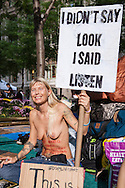 """New York City, NY, Sept 27th 2011, Zuna Tikka, 37 from Florida,  a participant of the Occupy Wall Street protest movement in Zuccotti Park  ( also know as Liberty Square) exercises her rights by going topless. """"I don't wear a shirt because it is legal not to in New York and I want to use what ever rights I still have before they are all taken away from me"""", she says. She has participated in the Occupy Wall Street since their movement began on Sept. 17th.  A core group of approximately 300 activists have held the plaza since the protest, inspired by the Egyptian Tahrir Square uprising, began.."""