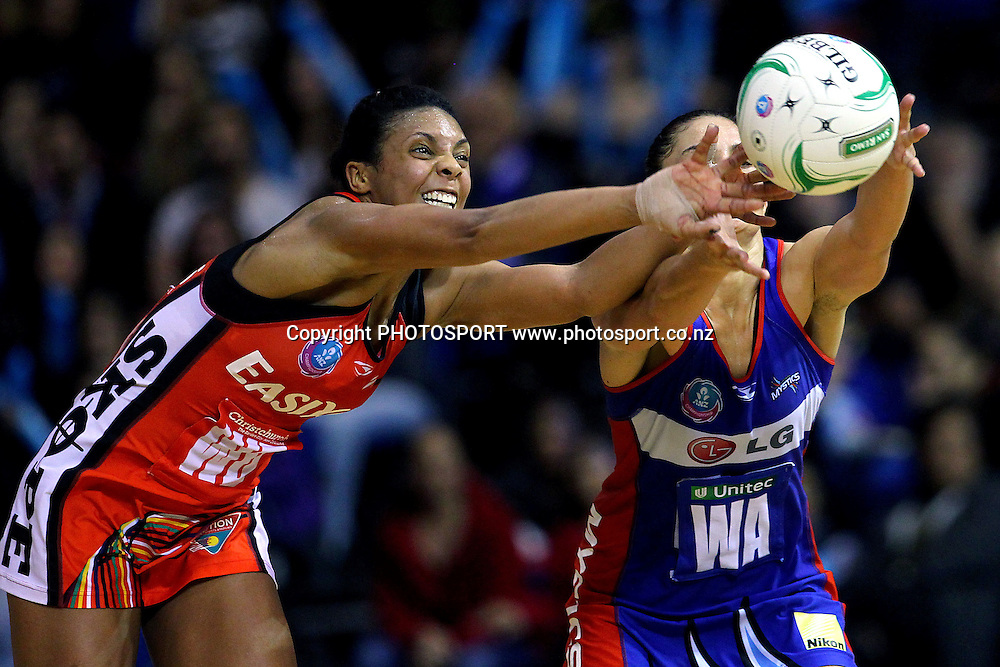 Tactix's Stacey Francis competes for the balla aginst Mystics' Temepara George. ANZ Netball Championship, Northern Mystics v Canterbury Tactix, Trusts Stadium, Auckland, New Zealand. Sunday 27th May 2012. Photo: Anthony Au-Yeung / photosport.co.nz
