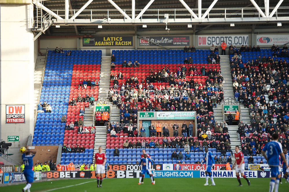WIGAN, ENGLAND - Saturday, February 26, 2011: Empty seats during the Premiership match between Wigan Athletic and local rivals Manchester United at the DW Stadium. (Photo by David Rawcliffe/Propaganda)