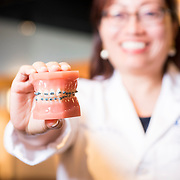 09/17/2016 - Boston, MA - Professor Melissa Ing returned clean dental models with braces to the Museum of Science on September 17, 2016. (Ian MacLellan for Tufts University)