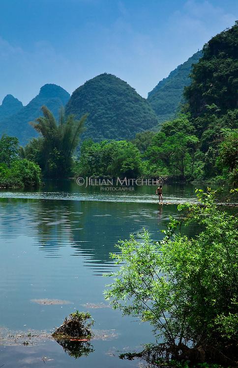 Man swimming in the Dragon River near Yangshuo.