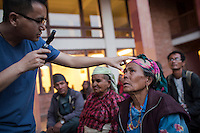 Mun Sang Tamang 60 before cataract surgery. Ruth and Rosa Hollows at Pullarhari Monestry for the outreach micro surgical eye camp held on the outsirks of the Kathmandu Valley 2014.