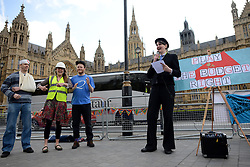 © Licensed to London News Pictures. 15/04/2013. London, UK. Global Day of Action on Military Spending (GDAMS) protesters perform ?Play the budget right?.street theatre at Old Palace Yard on April 15, 2013 in London. Campaigners from 39 organisations have been calling for a reduction in military and arms spending.Photo credit : Peter Kollanyi/LNP