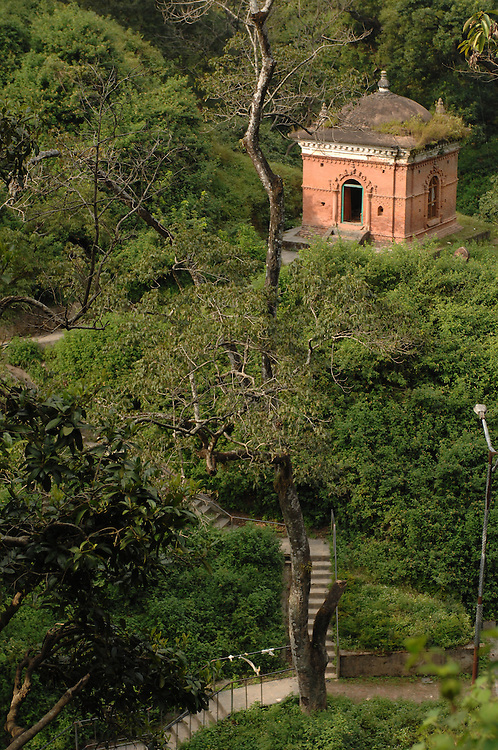 A small Buddhist temple among the trees in Kathmandu, Nepal.