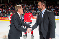 KELOWNA, CANADA - APRIL 14: Portland Winterhawks' head coach Mike Johnston congratulates Kelowna Rockets' head coach Jason Smith on the series win of the second round of WHL playoffs on April 14, 2017 at Prospera Place in Kelowna, British Columbia, Canada.  (Photo by Marissa Baecker/Shoot the Breeze)  *** Local Caption ***