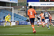 Millwall forward Lee Gregory scores to make it 1-0 during the Sky Bet League 1 match between Millwall and Blackpool at The Den, London, England on 5 March 2016. Photo by David Charbit.