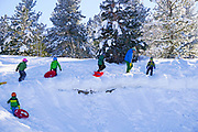 Family fun sledding in McCall, Idaho during winter. MR