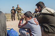 KURDISTAN, NORTHERN IRAQ, Dokuk.<br /> Qalubna Ma'Kum Feature:<br /> Qalubna Ma'kum (meaning &quot;Our hearts are With You&quot;) are a group of foreign volunteer fighters who have joined up with the Peshmerga in Kurdistan to help with the battle against Daesh, also known as ISIS. <br /> <br /> Pictured: Co-founders of Qalubna Ma'kum Kat Argo and Francis Cuvelier watch on as an internally displaced family waits for questioning.