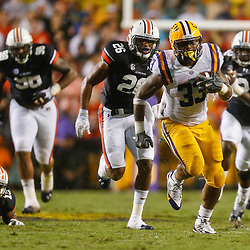 Sep 21, 2013; Baton Rouge, LA, USA; LSU Tigers running back Jeremy Hill (33) runs against the Auburn Tigers during the first half of a game at Tiger Stadium. Mandatory Credit: Derick E. Hingle-USA TODAY Sports