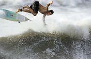 KEVIN BARTRAM/The Daily News.A surfer flies off his board while riding a wave near 61st Street and Seawall Boulevard on Thursday, Oct. 3, 2002. Big waves and high tides were about the only effects Hurricane Lili had on Galveston County.