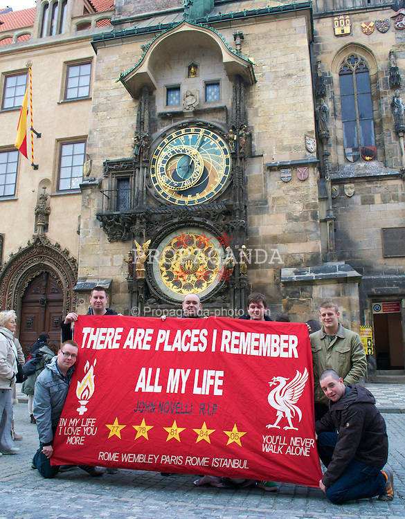 PRAGUE, CZECH REPUBLIC, Thursday, February 17, 2011: Liverpool supporters from Allerton and Mossley Hill unfurl their banner 'There are places I remember all my life' in front of the Starome?stsky? OrloJ in Starome?stske? Namest ahead of the UEFA Europa League Round of 32 1st leg match between Liverpool and AC Sparta Prague. (Photo by David Rawcliffe/Propaganda)