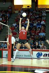 20 November 2004....Kelly Rikli sets up a kill....Illinois State University Redbirds V Drake Bulldogs Women's Volleyball.  Redbird Arena, Illinois State University, Normal IL