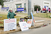 "1/22/13/  Jackson MS -Pictured is abortion rights activist Roy McMillan picketing outside the Jackson Women's Clinic ion the 40th Anniv. of Roe-v-vWade. Governor Bryant is attempting to close the clinic by making strict laws for the clinic and having the doctors have admitting privileges at local hospitals. The clinic is unable to comply with State law and is fighting to stay open. Governor Phil Bryant joins the PLAN (Pro Life America Network) and speaks at the Mississippi State capital in support of his Pro Life agenda on the 40th Anniversary of Roe-v-Wade. Governor Bryant asked  for people to ""pray for the unborn babies"" and Bryant is pushing hard to close the States only operating Abortion Clinic. Photo© Suzi Altman"