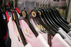 Rack of size 10 women's clothes in a department store,