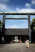 An elderly man walks through the grounds of Yasukuni Shrine in Tokyo, Japan in December 2007. Every year on August 15, the day Japan officially surrendered in WWII, tens of thousands of Japanese visit the controversial shrine to pay their respects to the 2.46 million war dead enshrined there, the majority of which are soldiers and others killed in WWII and including 14 Class A convicted war criminals, such as Japan's war-time prime minister Hideki Tojo. Each year speculation escalates as to whether the country's political leaders will visit the shrine, the last to do so being Junichiro Koizumi in 2005. Nationalism in Japan is reportedly on the rise, while sentiment against the nation by countries that suffered from Japan's wartime brutality, such as China, has been further aggravated by Japan's insistence on glossing over its wartime atrocities in school text books...Photographer:Robert Gilhooly..Photographer:Robert Gilhooly