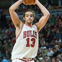 19 December 2009: Chicago Bulls center Joakim Noah grabs a rebound during the Chicago Bulls 101-98 victory in overtime over the Atlanta Hawks at the United Center, in Chicago, Illinois, USA.