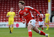 Goalscorer Tom Bradshaw celebrates scoring first goal during the Sky Bet League 1 match between Walsall and Milton Keynes Dons at the Banks's Stadium, Walsall, England on 14 March 2015. Photo by Alan Franklin.