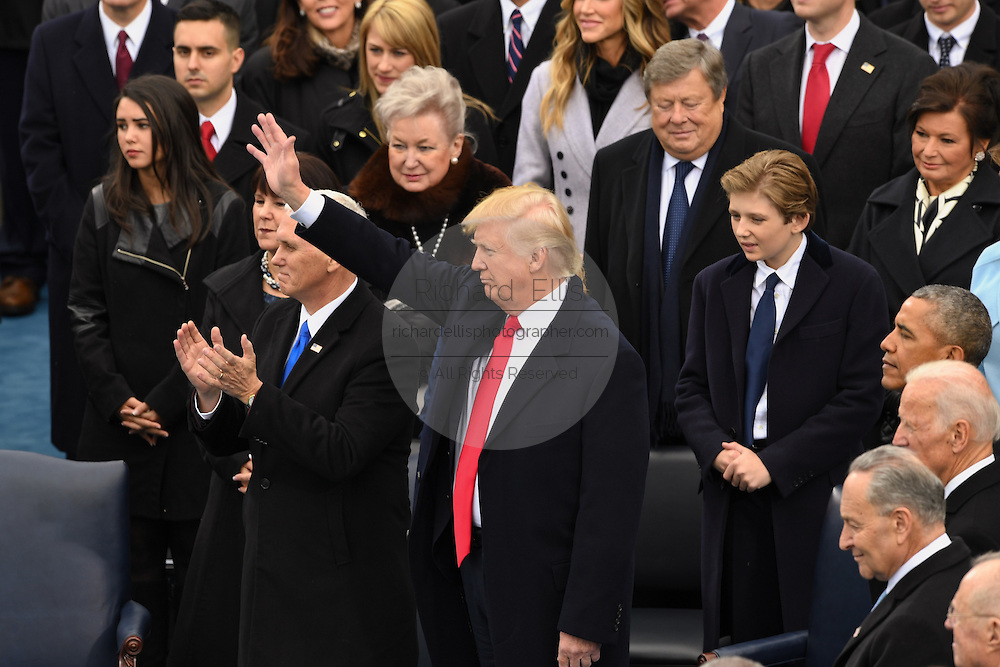 President Donald Trump waves after taking the oath of office to to become the 45th President of the United States during the Inaugural ceremony January 20, 2017 in Washington, DC.