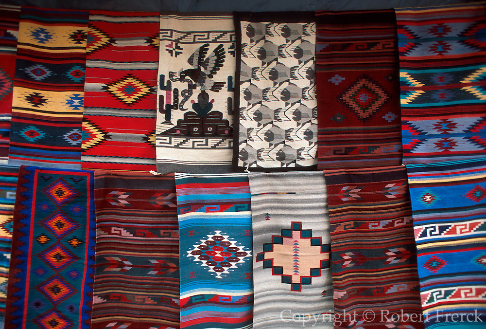 MEXICO, MARKETS, Oaxaca: Zapotec Indian weavings on display  for sale to tourists. These textiles are some of Mexico's finest weavings