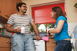 Young people in a kitchen, including young woman with Cerebral Palsy.