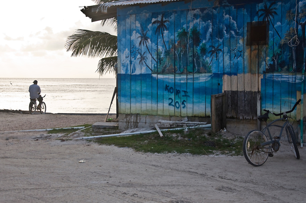 A boy looks out over the Caribbean next to a restaurant on Cay Caulker, Belize.   July 2009.  (Photo/William Byrne Drumm)