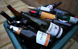 Empty bottles of alcohol lie in a recycling box after the Christmas period.