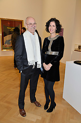 Artist JOHN DUNBAR and MOLLIE DENT-BROCKLEHURST at the opening private view of 'A Strong Sweet Smell of Incense - A portrait of Robert Fraser, held at the Pace Gallery, Burlington Gardens, London on 5th February 2015.
