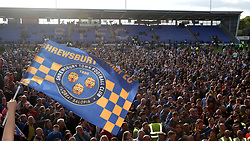 Fans invade the pitch at the end of the Sky Bet League One play-off second leg match at Montgomery Waters Meadow, Shrewsbury.