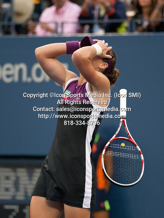 Sept. 11, 2011<br /> Samantha Stosur of Australia, drops her racquet as she celebrates winning her first US Open title defeating the USA's Serena Williams in the final of the US Open being played at the USTA Billie Jean King National Tennis Center, Flushing Meadow, NY