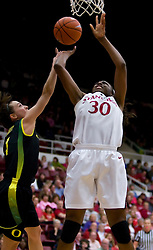February 18, 2010; Stanford, CA, USA;  Stanford Cardinal forward Nnemkadi Ogwumike (30) shoots past Oregon Ducks guard Taylor Lilley (1) during the second half at Maples Pavilion. Stanford defeated Oregon 104-60.