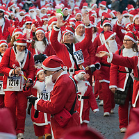 NOALE, ITALY - DECEMBER 18:  Participants dressed as Father Christmas take part in the Noale Sant Run on December 18, 2011 in Noale, Italy. Close to two thousand people participated in the third annual Noale Santa Run, one of the largest non competitive Santa Run in Italy.