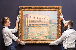 "© Licensed to London News Pictures. 20/02/2019. LONDON, UK. Technicians hold ""Le Palais Ducal"", 1908, by Claude Monet (Est. £20-30m). Preview of Sotheby's Impressionist & Modern and Surrealist Art sales.  The auction will take place at Sotheby's New Bond Street on 26 February 2019.  Photo credit: Stephen Chung/LNP"