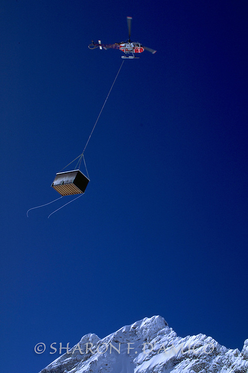 A Helicopter Carries Supplies High in the French Alps