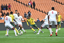 South Africa: Johannesburg: Bafana Bafana player Percy Tau makes a beautiful pass for his team mate, during a game with Seychelles for the Africa Cup Of Nations qualifiers at FNB stadium, Gauteng.<br />