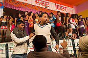 A drunk Indian man is having an argument in front of a group of young women performing on stage at one of the regular night dance shows being set up during the yearly Sonepur Mela, Asia's largest cattle market, in Bihar, India.