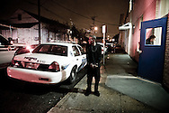 December 26th 2011, New Orleans, <br /> A man waits in handcuffs in front of the 5th Precinct police station after being arrested by Officer DeSalvo. New Orleans crime rate is among the highest in America and is considered to be one of the most dangerous cities in the world.