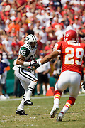 New York Jets wide receiver Laveranues Coles looks at Kansas City Chiefs safety Sammy Knight after catching a pass during a 27 to 7 Chiefs win on September 11, 2005 at Arrowhead Stadium in Kansas City, Missouri.