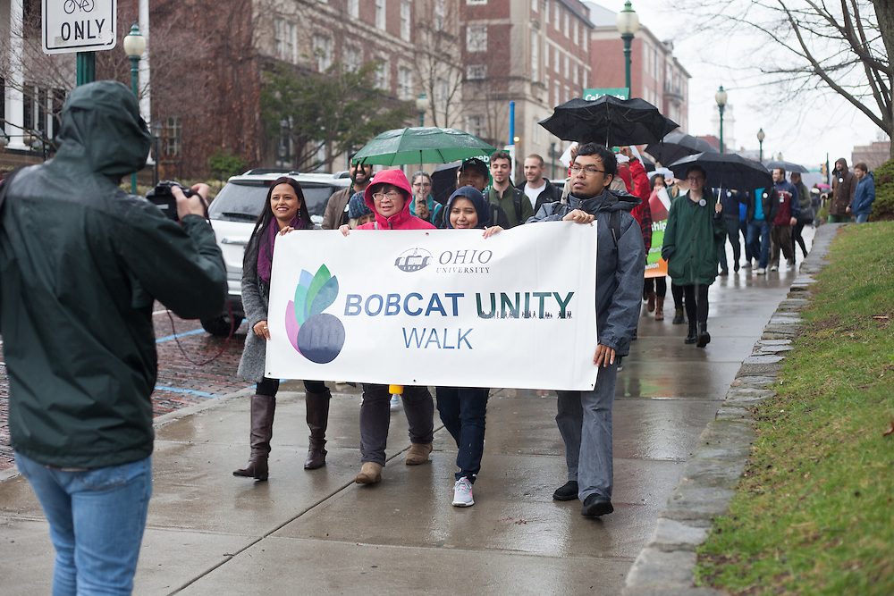 (L-R) Deepali Sharma, Lina Himawan, Elizarni, and Bina Sitepu lead with the Bobcat Unity Walk banner on College Green on Tuesday, Feb. 28, 2017. © Ohio University / Photo by Kaitlin Owens