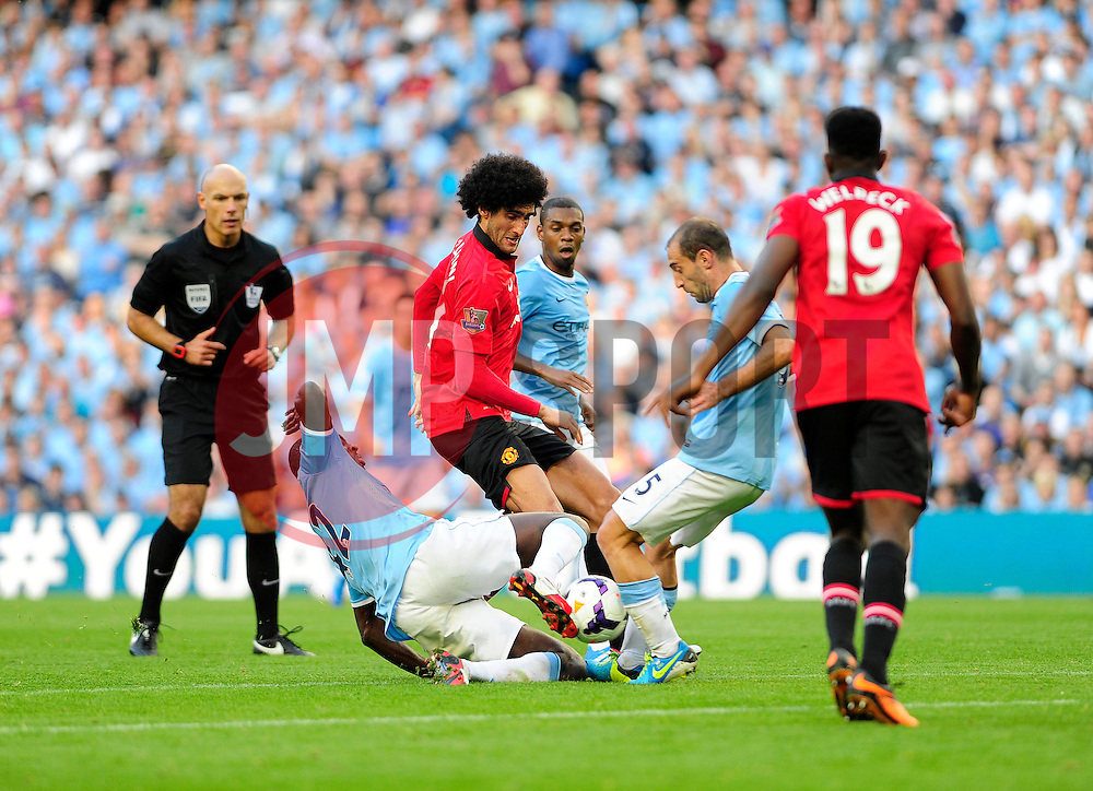 Manchester City's Yaya Toure and Manchester City's Pablo Zabaleta gets in each others way - Photo mandatory by-line: Dougie Allward/JMP - Tel: Mobile: 07966 386802 22/09/2013 - SPORT - FOOTBALL - City of Manchester Stadium - Manchester - Manchester City V Manchester United - Barclays Premier League