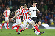 Stoke City midfielder James McClean and Derby County forward Tom Lawrence challenge for the ball during the EFL Sky Bet Championship match between Derby County and Stoke City at the Pride Park, Derby, England on 12 March 2019.
