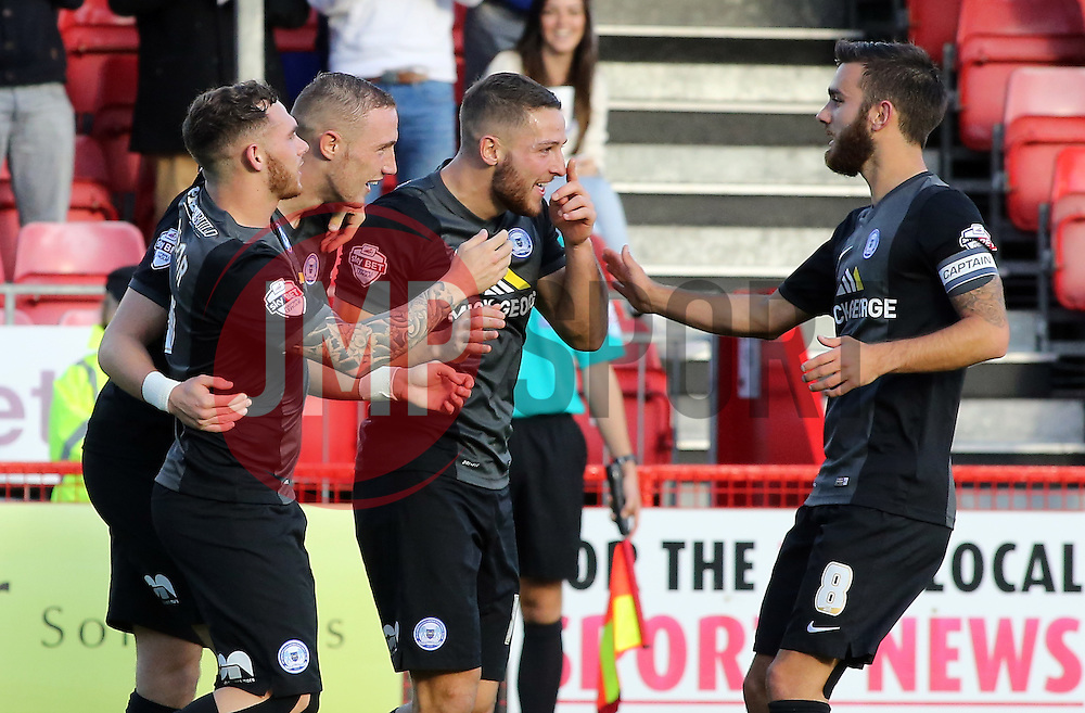 Peterborough United's Marcus Maddison celebrates scoring his goal with team-mates - Photo mandatory by-line: Joe Dent/JMP - Mobile: 07966 386802 - 11/10/2014 - SPORT - Football - Crawley - Checkatrade.com Stadium - Crawley Town v Peterborough United - Sky Bet League One