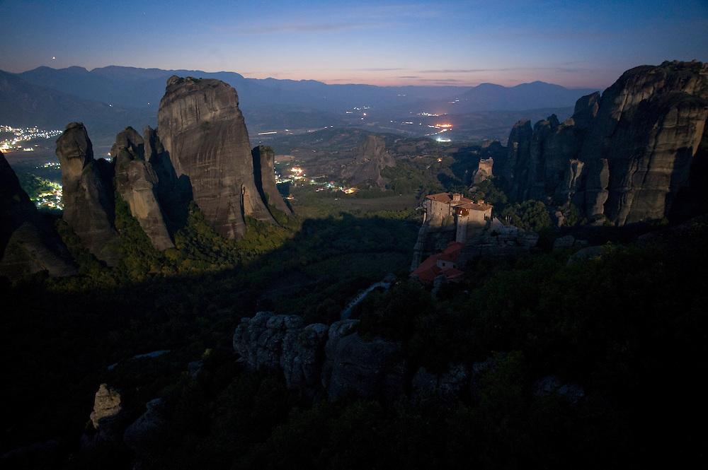 Greece, Meteora, Roussanou Monastery in light of rising Moon