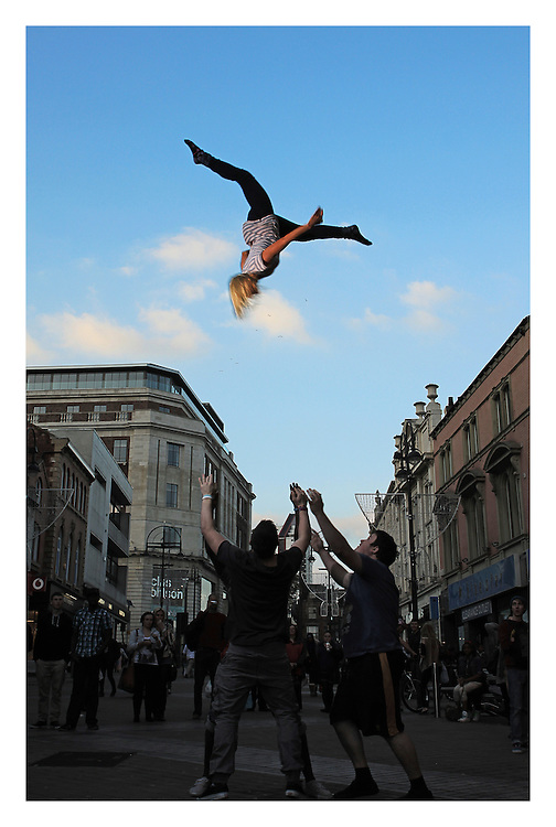 The Aviator Allstars doing a cheerleading Pike split basket toss in the middle of Briggate, Leeds, LS1.