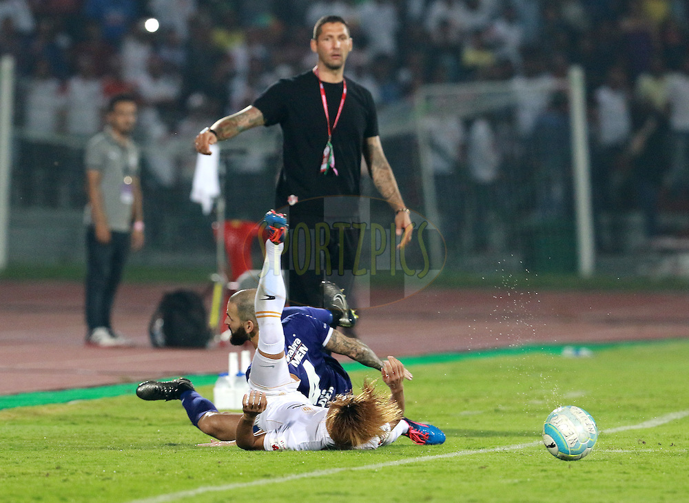 Hans Mulder of Chennaiyin FC collides with Katsumi Yusa of NorthEast United FC during match 18 of the Indian Super League (ISL) season 3 between NorthEast United FC and Chennaiyin FC held at the Indira Gandhi Athletic Stadium in Guwahati, India on the 20th October 2016.<br /> <br /> Photo by Vipin Pawar / ISL/ SPORTZPICS