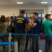 SEPTEMBER 23 - MIAMI, FLORIDA - <br /> First responders and passengers wait in ,in to be rebooked after their 7:20AM flight to Puerto Rico was cancelled. Many are trying to reach those affected by the destructive path of Hurricane Maria.<br /> (Photo by Angel Valentin for NPR)