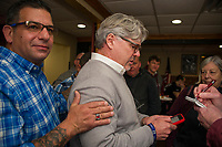 Philip Spagnuolo gives Andrew Hosmer support as he awaits the election results at the 405 on Tuesday evening.  (Karen Bobotas/for the Laconia Daily Sun)