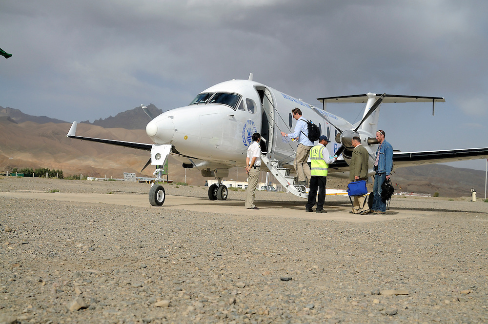 Danielle watchs passengers board the UNHAS flight on the remote Bamiyan air field.  The airstrip is made of rocks and gravel and not entirely straight, making take off and landings more challenging in the remote mountins...